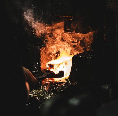 Forging hot steel billet under press